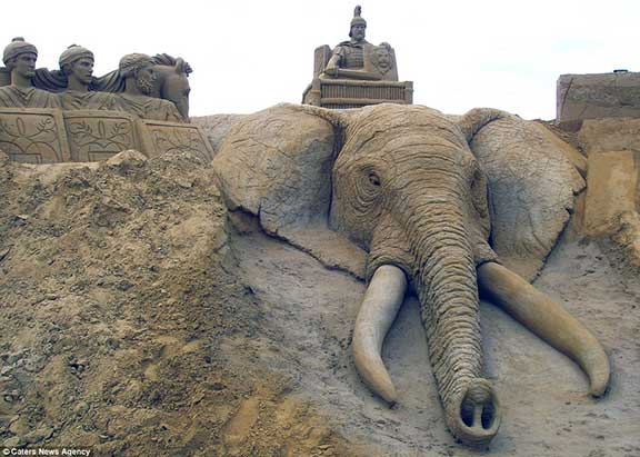homage to elephants, elephant art, sand sculpture, mechanical sculpture, origami animals, paper sculpture, animal protection, human and wildlife coexistence, paul hoggard